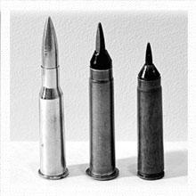 Опытные патроны с оперёнными подкалиберными пулями и штатный 7,62х54 патрон